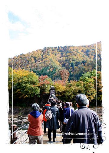 Ogimachi-crossing-the-shogawa-river